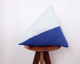 Berlingot cushion - blue geometric and plain blue patterns