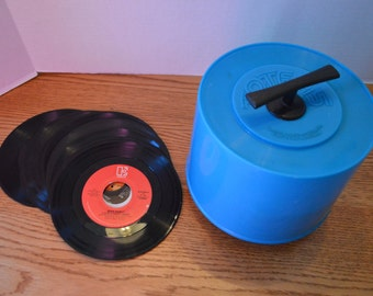 Collection of Forty-Four 45 RPM Records from the 1980's with Blue Tote Holder