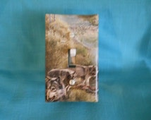 Light switch covers that are covered with theme fabric, photos from magazines and posters