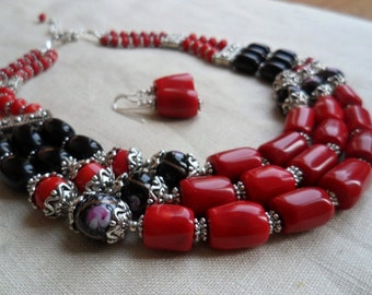 Natural coral Necklace with black onyx and lamp work beads.