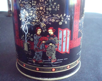 Set of three asian canister tins made by Presige