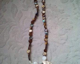Long necklace made with shell and abalone beads. Multicolored shell- brown, white, blue abalone