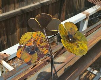 Hand painted metal pansies.