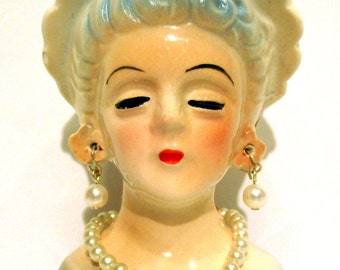 Vintage Miniature Lady Head Vase. Blue Dress with White Hat.  Like new condition.  Product No. 254010