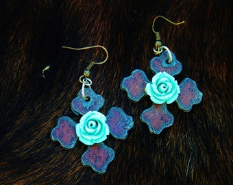 metal earrings with teal rose