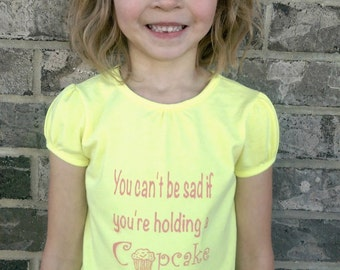 You can't be sad if you're holding a cupcake girls shirt