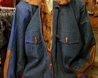 1980'-90' denim, leather and real fur lining jacket, with huge shoulder pads. Size S.