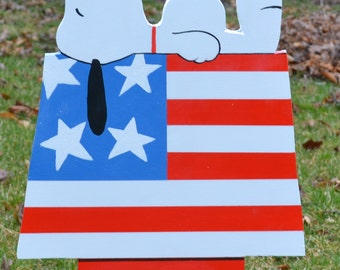 Snoopy from the Peanuts gang sleeping on Independance day July 4