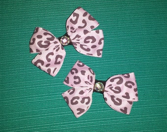 Pair of small pink leopard print bows