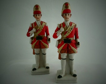 Pair of parian decanters / spirit bottles in the shape of fusiliers. Hand painted unglazed porcelain soldiers in fusilier uniform