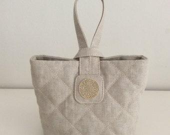 Linen quilted handbag: beige