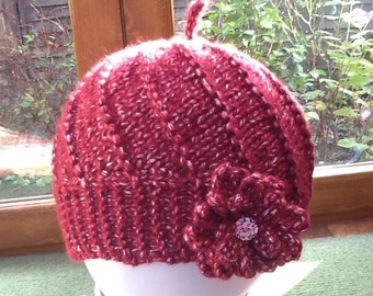 Hand knitted, cosy hat with flower and button decoration. Toddler, child, teenager, or adult. Winter. Christmas gift.