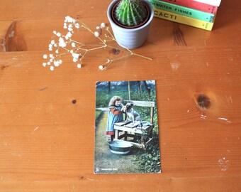 Vintage Postcard little girl with dog