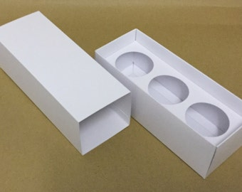 Votive candle boxes with insert for 3 small votive candles.