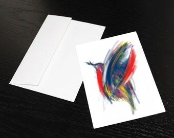 """Carte de souhaits """"Oiseau rouge, bleu, jaune"""". Format, une fois plié 5 x 7, intérieur blanc. Enveloppe comprise."""