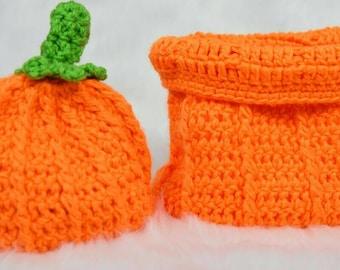 Newborn crochet pumpkin hat and cocoon photography prop.
