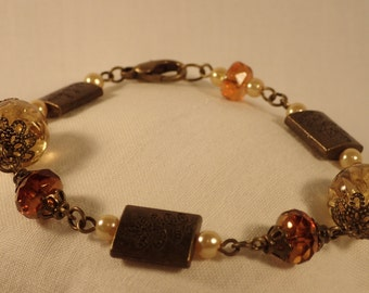 Yellow and orange antique brass bracelet