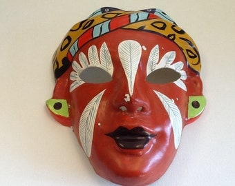 Vintage paper mâché hand painted mask from Asia. Red papier-mâché face mask from Asia with holes cut out for eyes. Asian painted face mask.