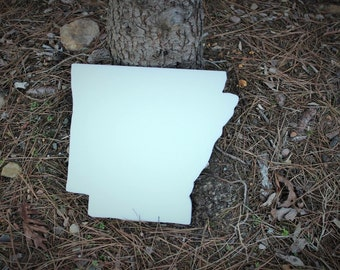Arkansas shaped plastic cutting board.