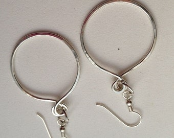 Round  medium size foraged dangle argentium silver earring.