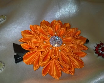 barrette with flower kanzashi orange satin ribbon and a silver rhinestone