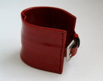 Johnny Farah, red leather bracelet