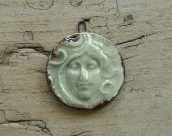 Handmade ceramic face pendant