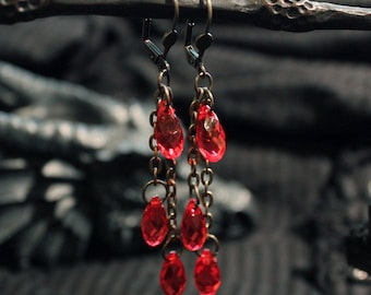 -Dangle earrings in brass bronze colour and red beads