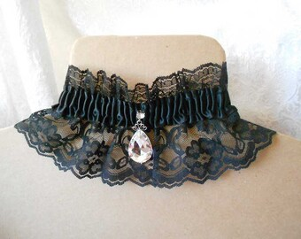 Black lace choker with gathered satin and dazzling teardrop accent, adjustable tie-back ribbon