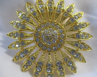 Gold Toned and White Rhinestone Sunburst Brooch