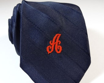 Vintage Prince Consort A Initial Letter Personalized Tie Navy Blue Orange Logo?