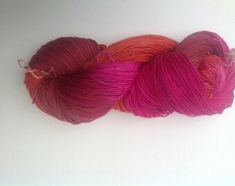 sock yarn,   hand dyed sock yarn, , Superwash wool and nylon blend .   Burnt sienna, copper , fuchsia , fall colors, Autumn shades.