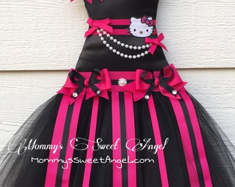 Hello kitty tutu bow holder. Chic black and hot pink tutu bow holder. Cute birthday, baby shower gift. Customize to any colors!!!