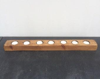 Wooden reclaimed seven tea light candle holder.