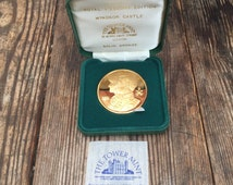 The tower mint - Windsor Castle / Prince Charles and Princess Diana coin, solid bronze.