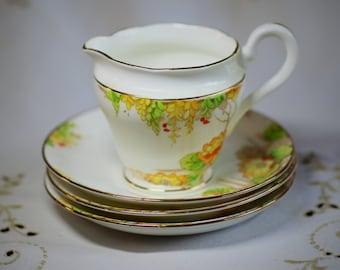Vintage jug and saucer set