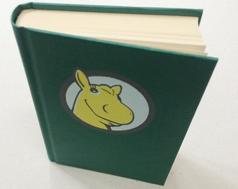 Small hardcover blanc book, sketchbook, journal, with a screen print in 3 colors of John the yellow horse