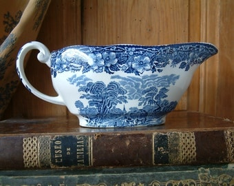Vintage English blue transferware oval sauce / gravy boat.  English ironstone. Enoch Wedgewood Tunstall. Woodland pattern