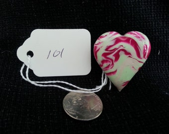 These are my candy hearts pins.Pinkish red and light green