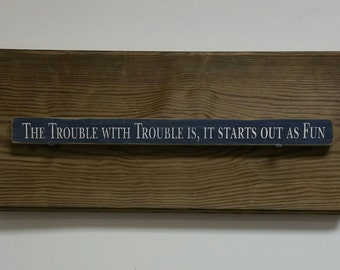 The trouble with trouble is it starts out as fun shelf decor pictured in navy