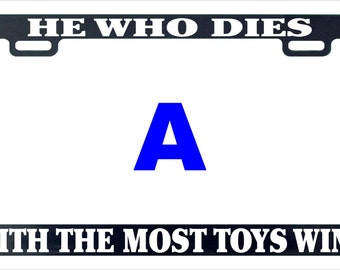 He who dies with most toys wins funny assorted license plate frameme
