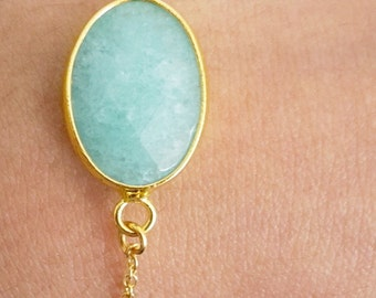 Minimal gold plated oval jade (mint) green semi precious stone and 24K gold plated bird charm chain bracelet