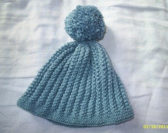Childs airforce blue bobble hat in decorative ribbing