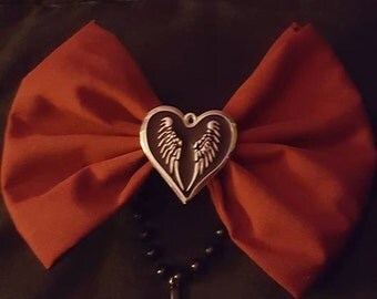 cross and winged heart bow