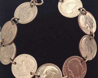 """Dime bracelet with silver loops comes in 7"""""""