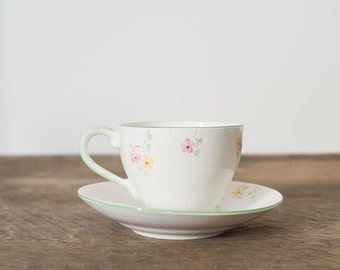 Cup and Saucer with Blossom Decoration
