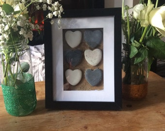 Pebble heart in deep frame