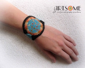Turquoise, orange and black crochet bracelet