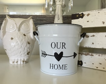 Housewarming gift! White pail with words, Our Home and arrow.