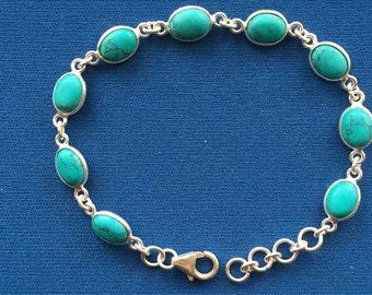 Turquoise set Sterling Silver linked cabochon bracelet